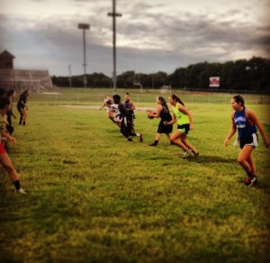 Playing flag football during conditioning.
