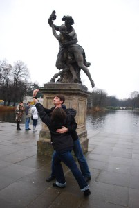 Choir members Ariel Silva and Aaron Tschetter mimic a statue in Lazienki Park.