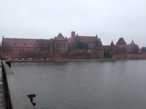 Outside view of the Malbork Fortress, a Gothic castle that is the biggest brick fortress in the world (construction beginning in 1274).